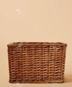 natural brown wicker basket on beige background